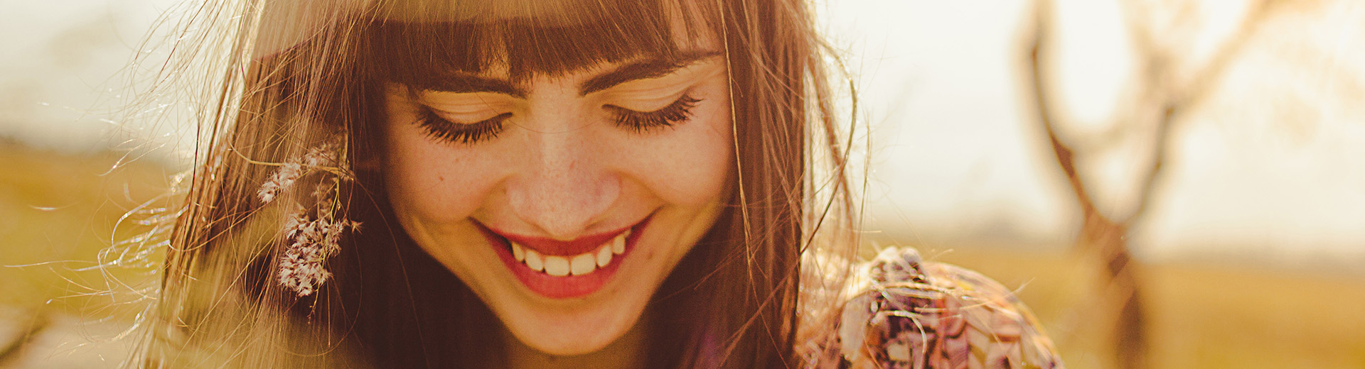 girl smiling in sunshine